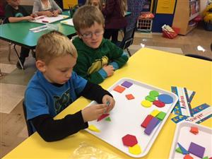 Bradlee & Todd are working together to sort their shapes.